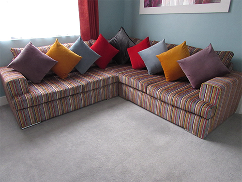 Kellie Hodge Corner Sofas In A Bright Amazilia JO-231 Velvet Fabric