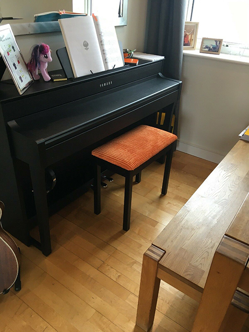 Didcot90 Orange Corduroy Fabric Used To Upholster A Piano Stool