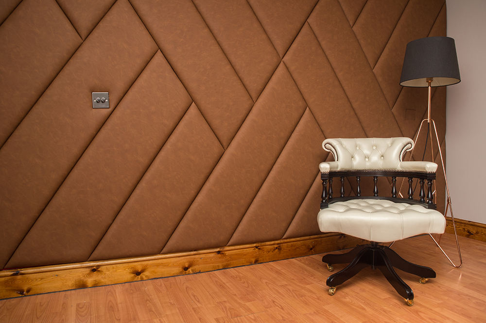An upholstered wall using a material called Chester 80 from the Yorkshire Fabric Shop